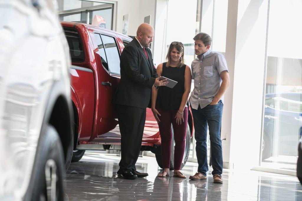car shoppers at dealership