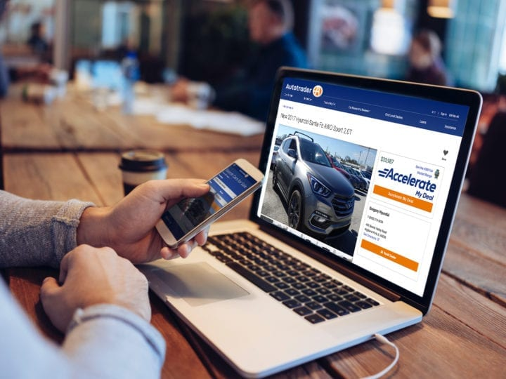 car shopper looking at Autotrader VDP with Accelerate My Deal digital retailing