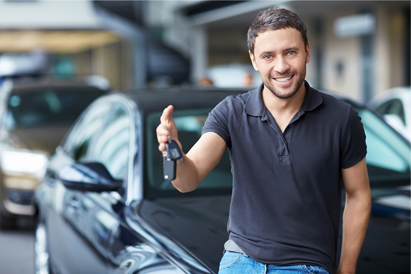 new car buyer with car keys